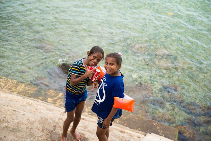 girls-swimming-in-Jayapura-Bay-Papua-Indonesia-Naomi-VanDoren.jpg
