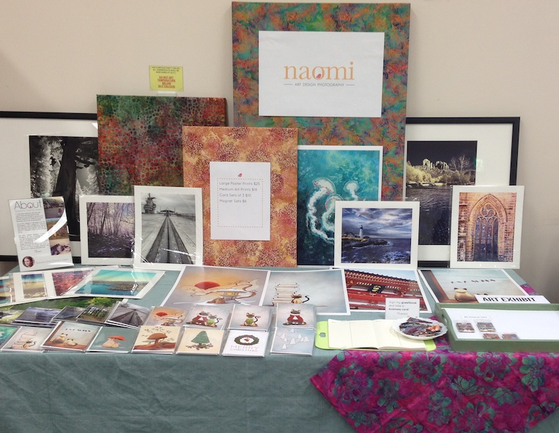 My table at my first craft fair, a fairly casual event. Displaying my photography and siamese cat illustrations.