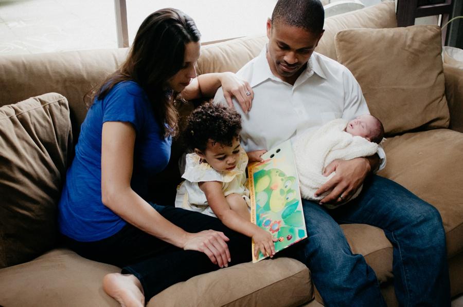 family with newborn baby