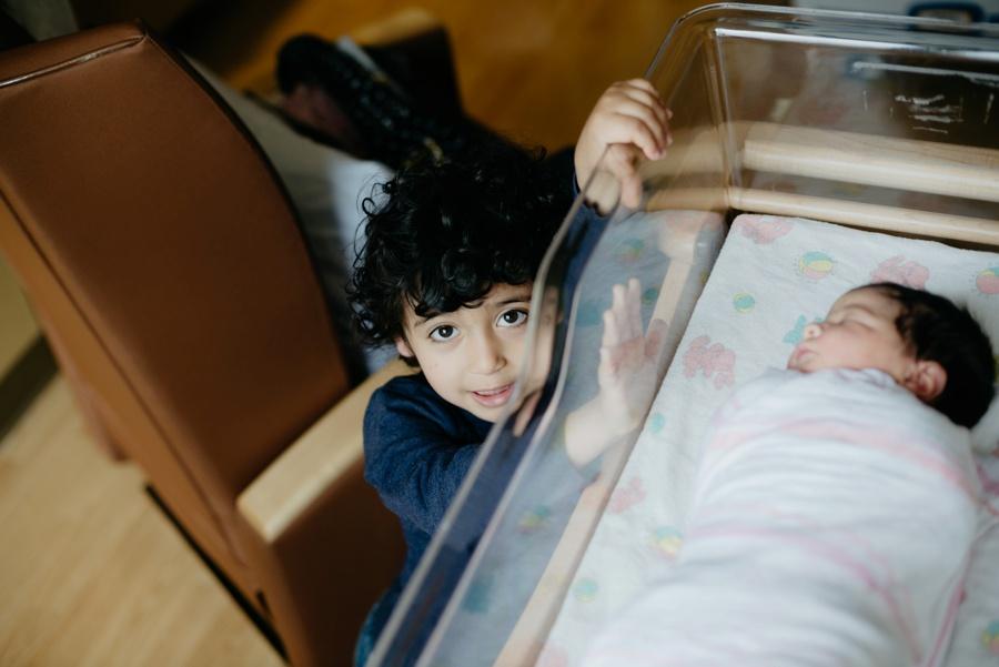 big brother and newborn baby