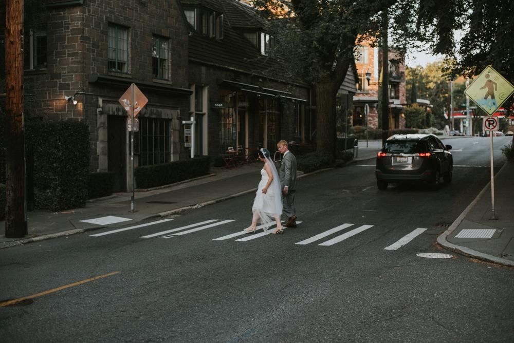 bride and groom crossing street