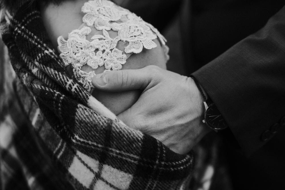 groom touching brides shoulder