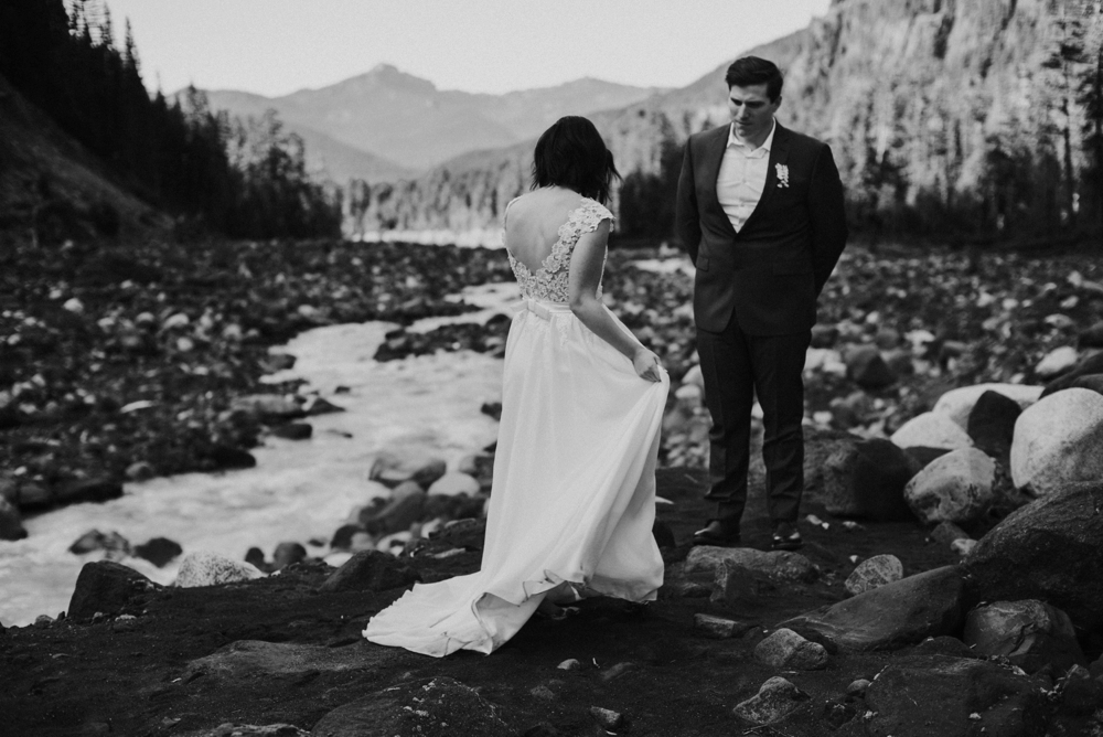husband watching wife in wedding dress
