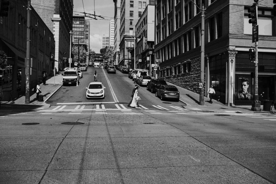 couple crossing street in Seattle