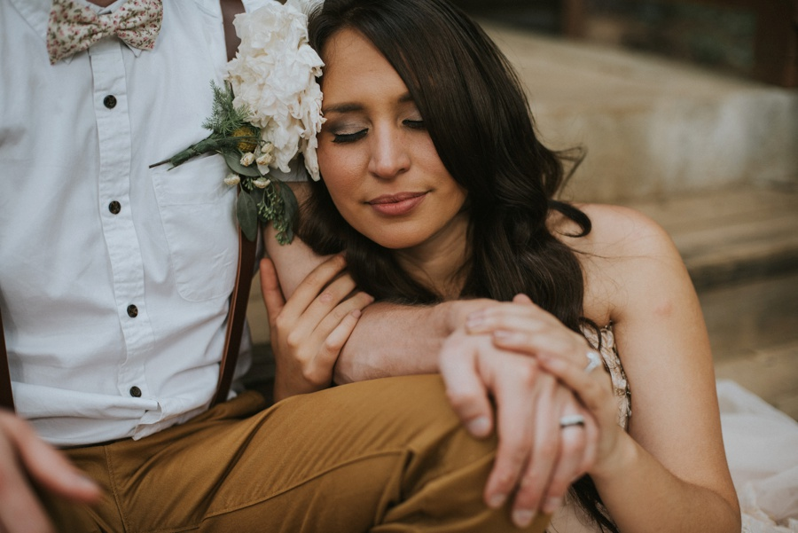 bride holding groom