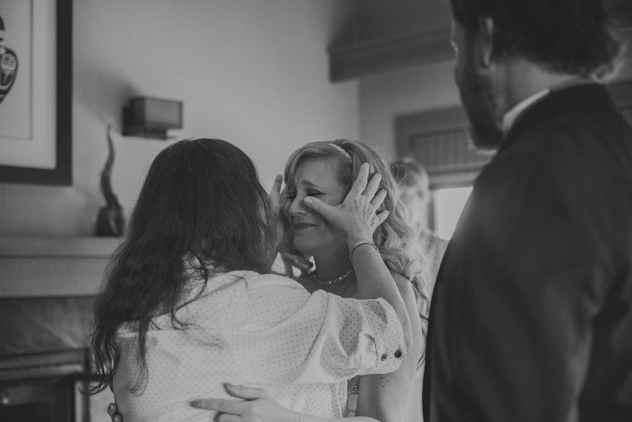 mother in law wiping brides tears