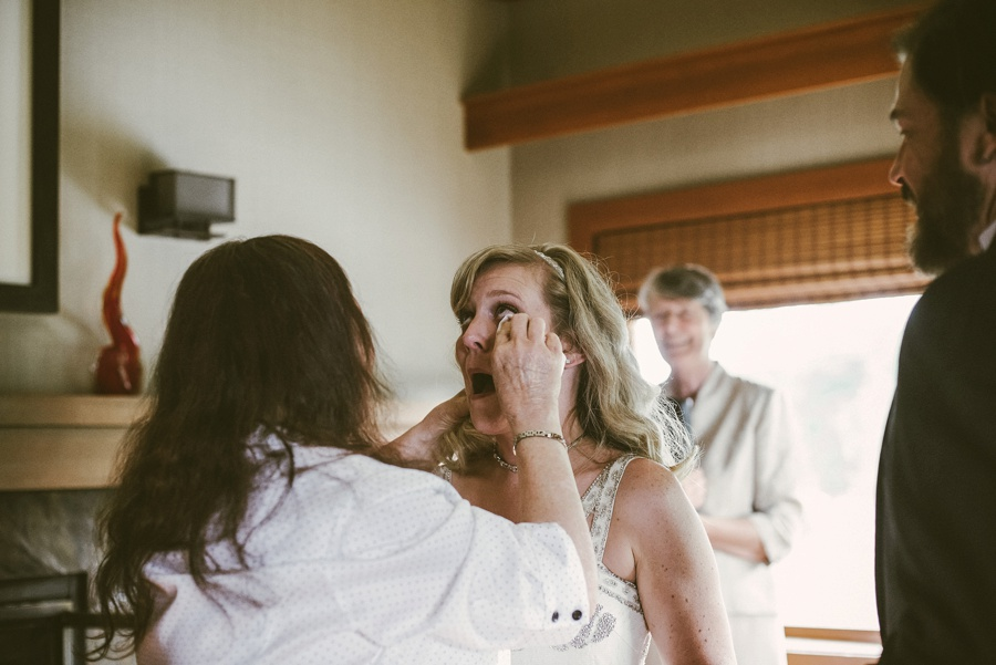 bride getting tears wiped by mother in law