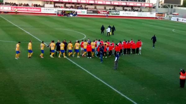 Players greet each other before the game begins.
