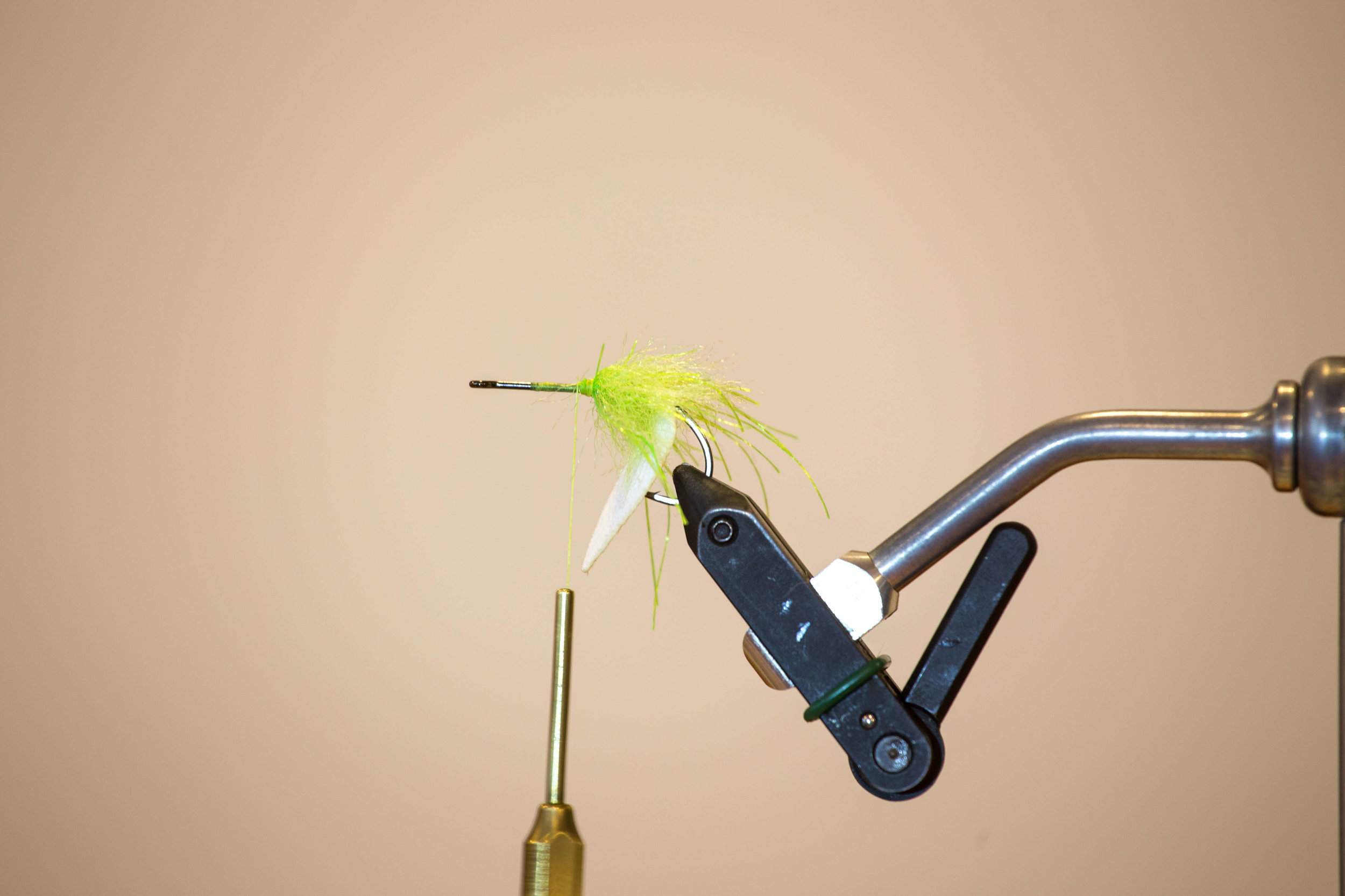 STEP 5 - Tie in first piece of EP brush above hook barb and palmer up hook.