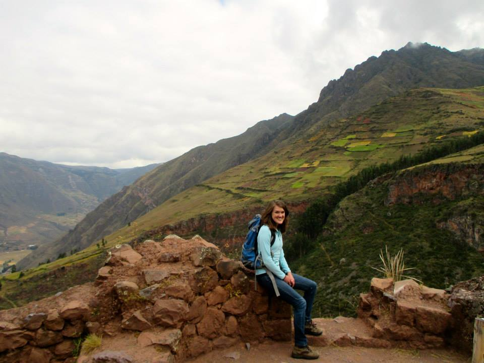 Becca stops to check out the native plants while hiking in Peru.
