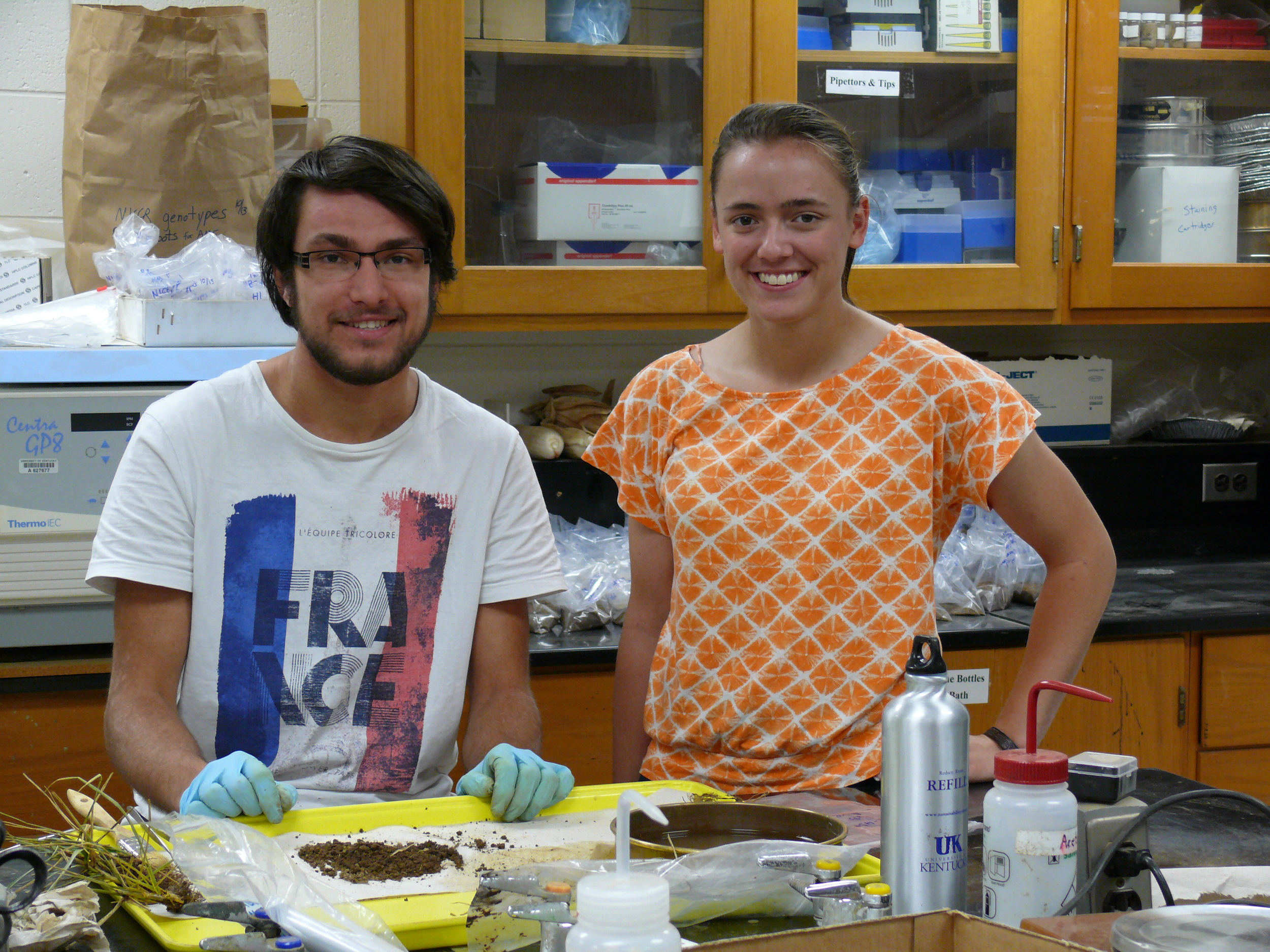 Pierre and Anna Joy cleaning roots from the climate change project.