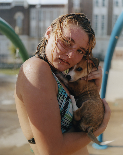 Woman holding a dog by Gregory Halpern from A collecdtion