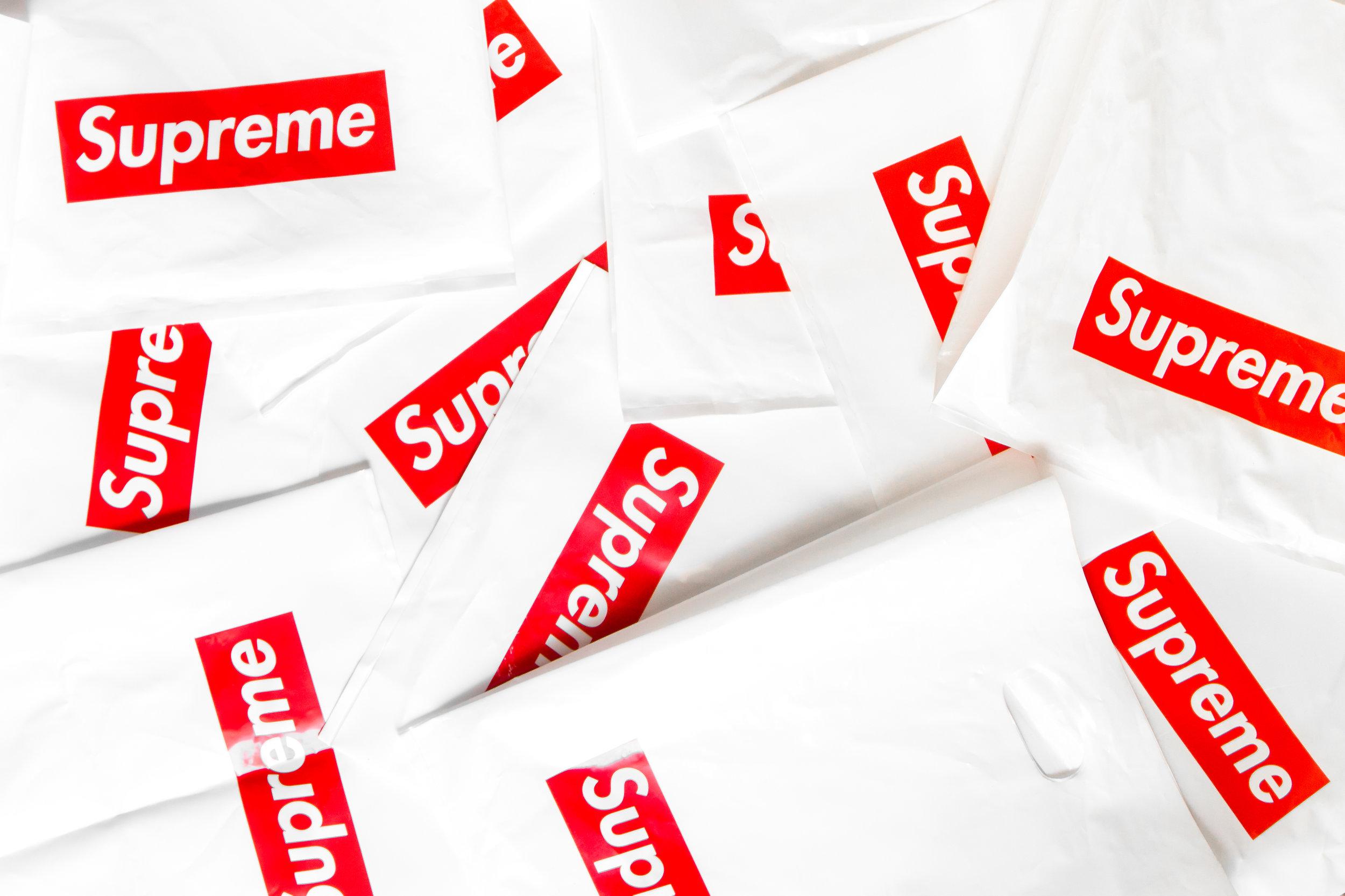 Supreme logos on bags