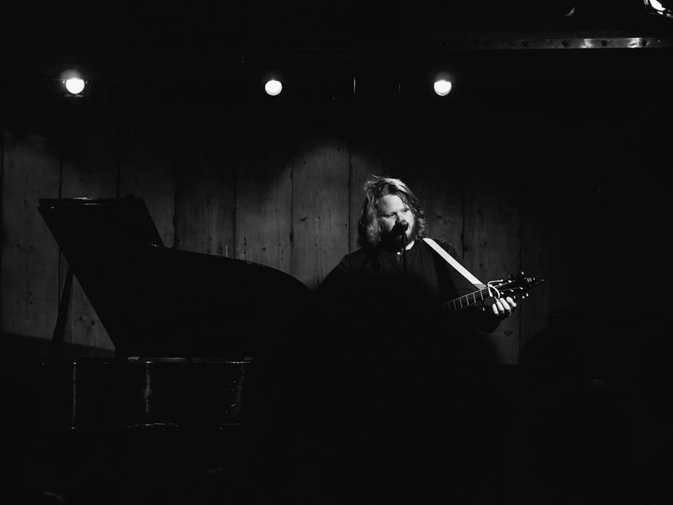 J. Alan performing live at Rockwood Music Hall. Photo courtesy of Derek Springsteen.