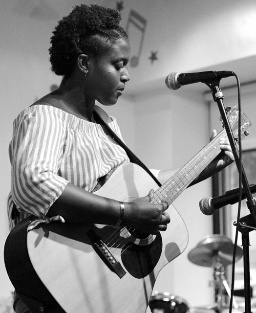 Siobhan Francis on the guitar at BMHC. Photo courtesy of A. Quiles.