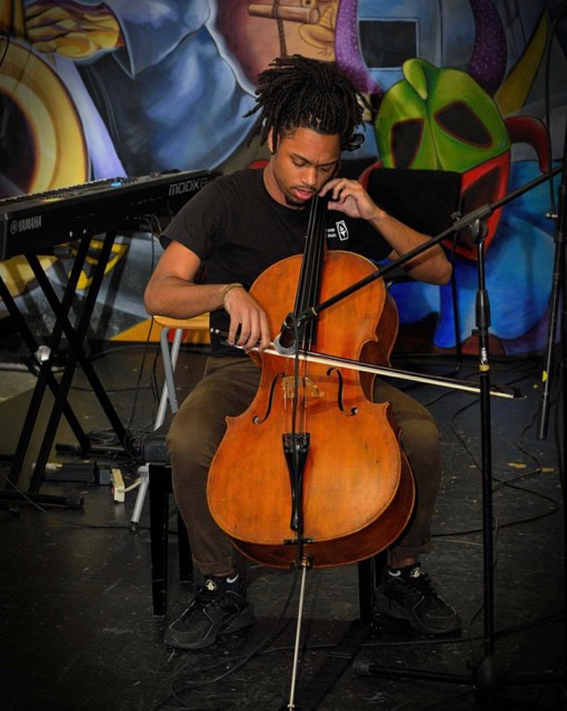 Richard Jimenez on the Cello at BMHC. Photo courtesy of A. Quiles.