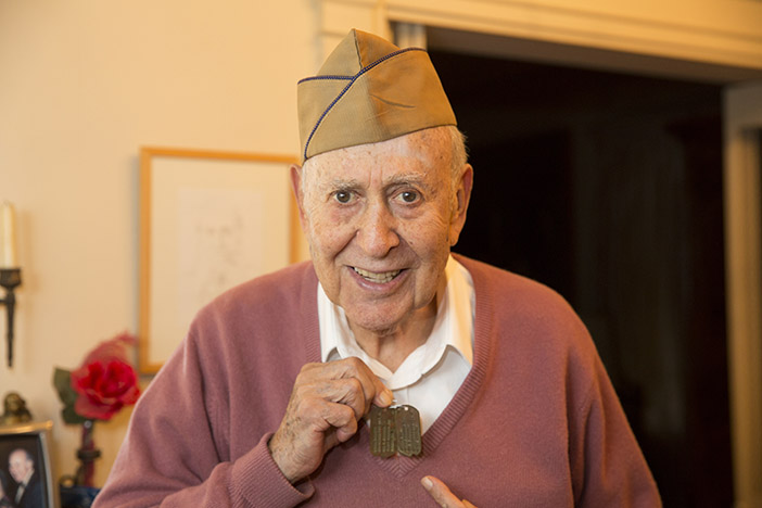 Carl Reiner at the GI JEWS interview in his Los Angeles home, December 2014. He is wearing his army hat and holding up his dog tags, which were marked H for Hebrew Credit: Turquoise Films