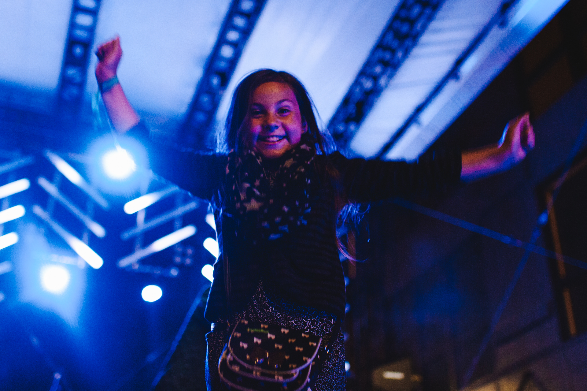 This little girl was lifted up onto the speaker at the end of Head Wound City's set to jump and dance