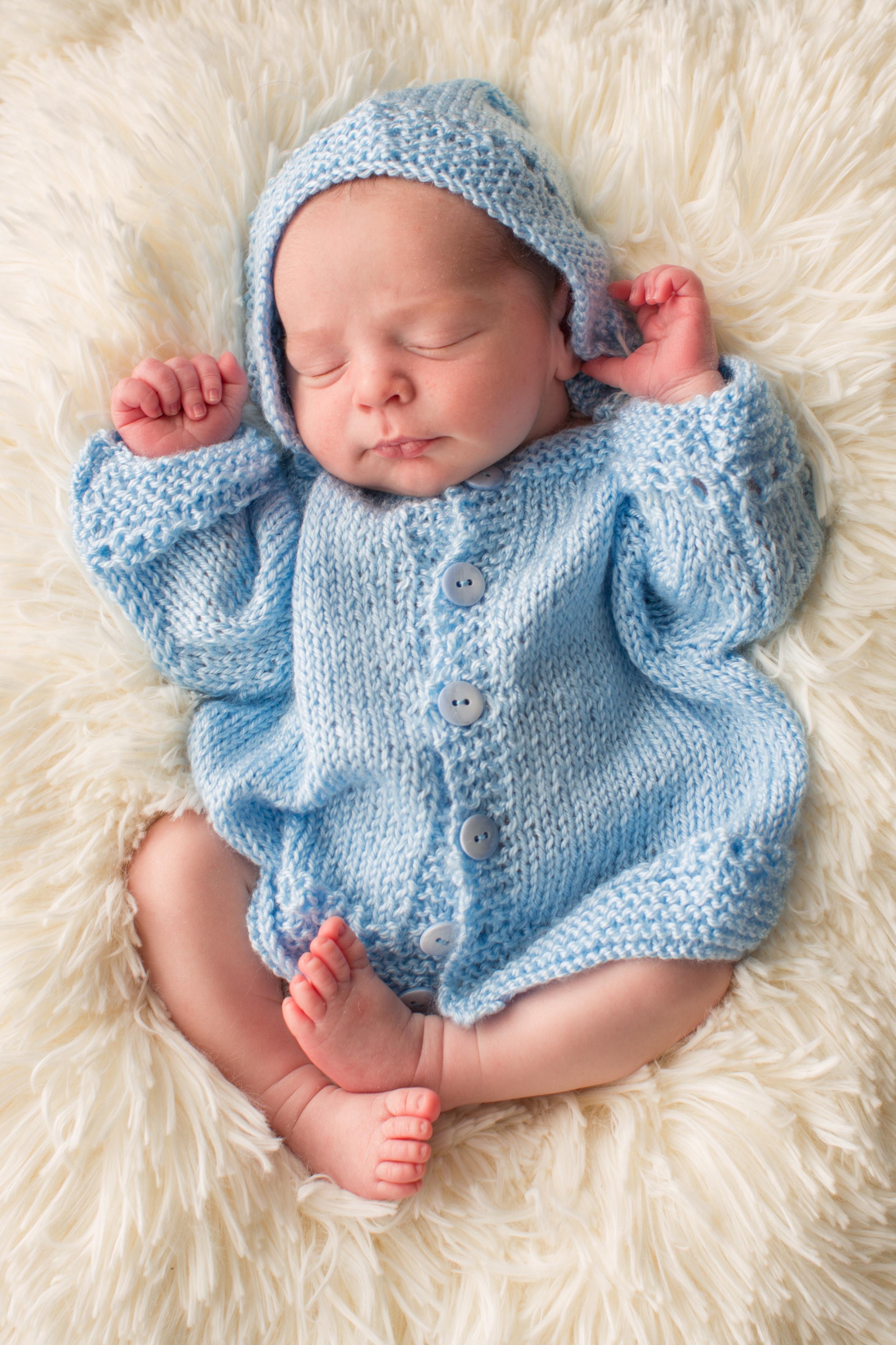 newborn baby in blue .jpg