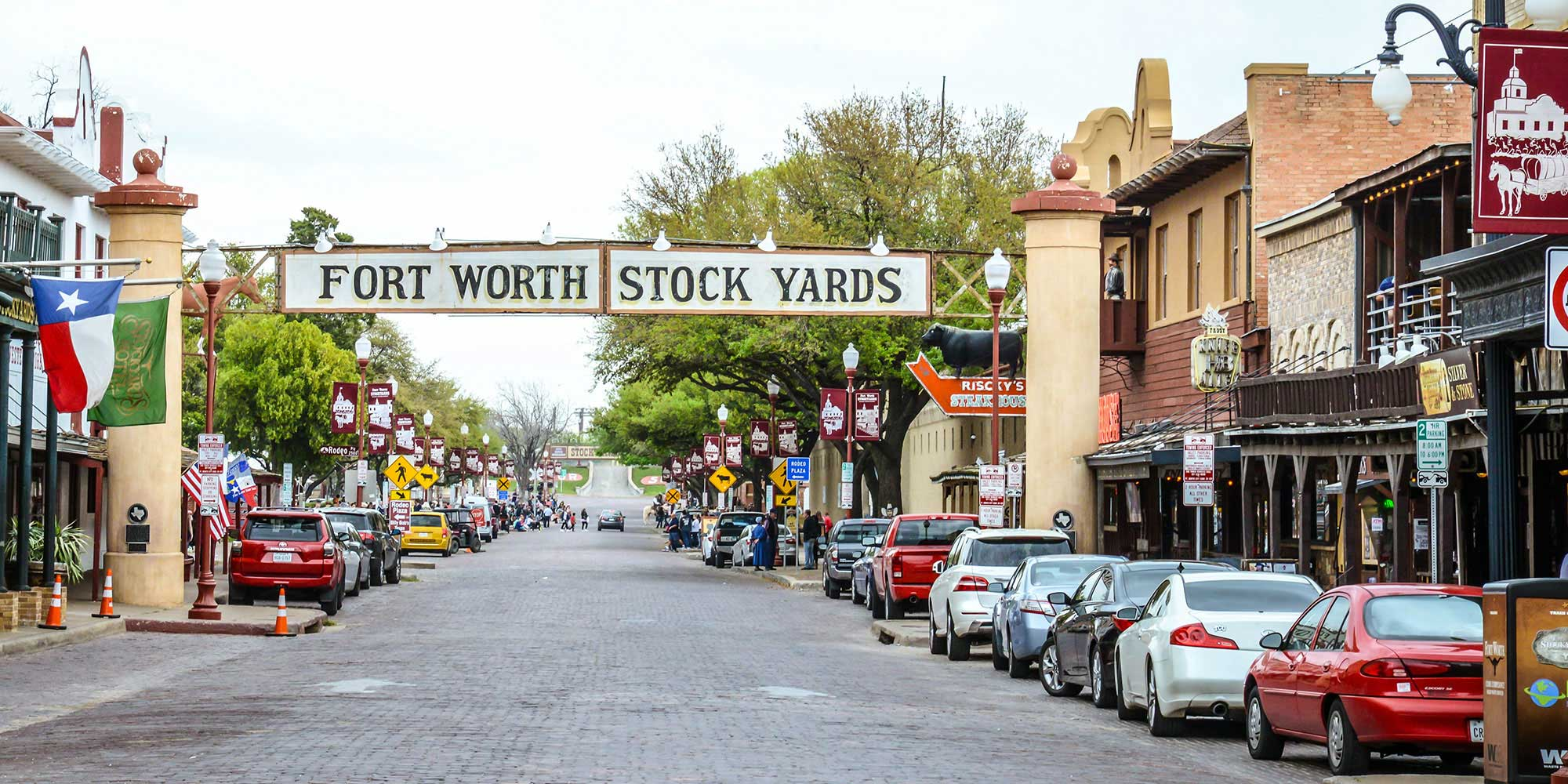 Stockyards - Photographing clients in the historic Northside of Fort Worth is tons of fun. From the iconic brick road down the center to the wooden pens in the back, there are so many great photo spots in the Stockyards, it's near impossible to hit them all.