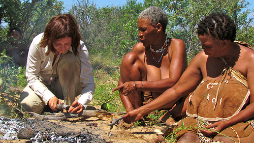 Here Tsumxai and Koba are teaching one of our participants about how they cook on the fire and how they open the maramba beans.