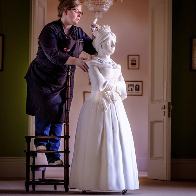 "While we're prepping this weekend's wedding cakes, enjoy a closer look at our diminutive (4ft10"") Victoria-sponge Queen Victoria, created for the 200th anniversary of her birth, for @englishheritage .  You'll find the gardeners of Osborne House (who helped her in)... they're normal heighted folks! Particularly strong though, as though she was short, she weighed in at around 15stone / 95kg / 210lbs. There was a whole lot of eating in her! . . . #cake #cakeart #extremecakemakers #victoria #queenvictoria #victoriaandalbert #historyinthemaking #osbornehouse @englishheritage #youngvictoria #victorian #itvvictoria"