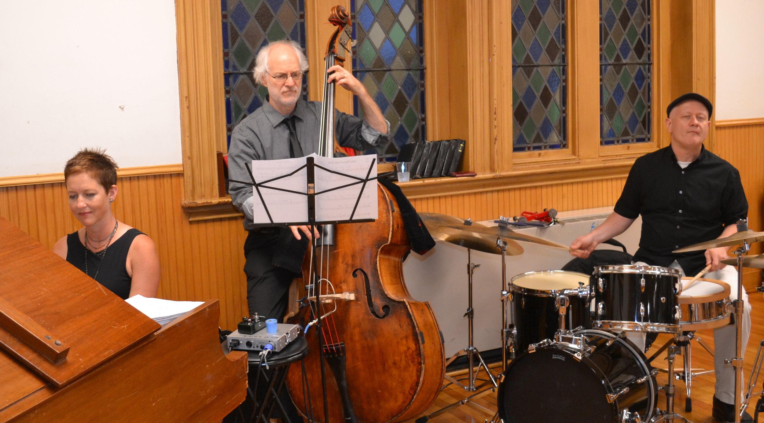BFU members Rebecca Cline, Dave Clark, and Bertram Lehmann performing at the ESWA event