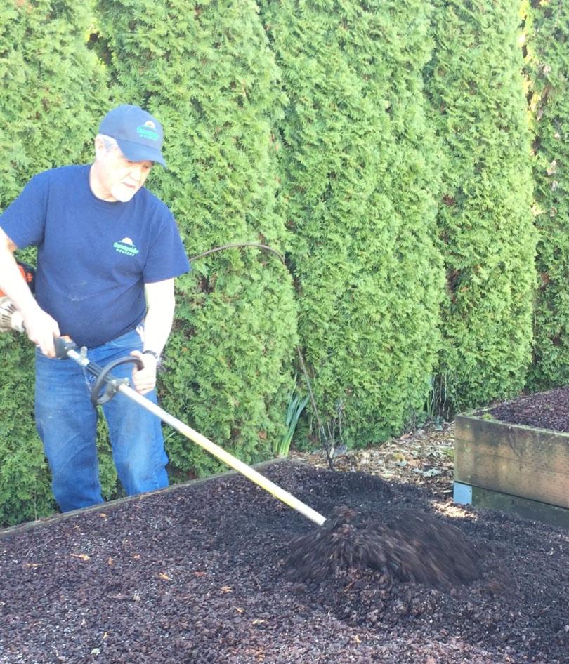 Steve rototilling veg bed.jpg