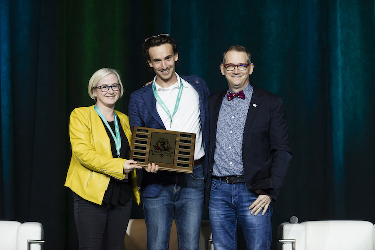 Past A100 Chair, Stephen King, presents the Alex Raczenko Pitch Award to the 2019 winner, Pierre Wijdenes, CEO & Co-Founder, Neuraura, and Co-Founder, Claire Dixon.