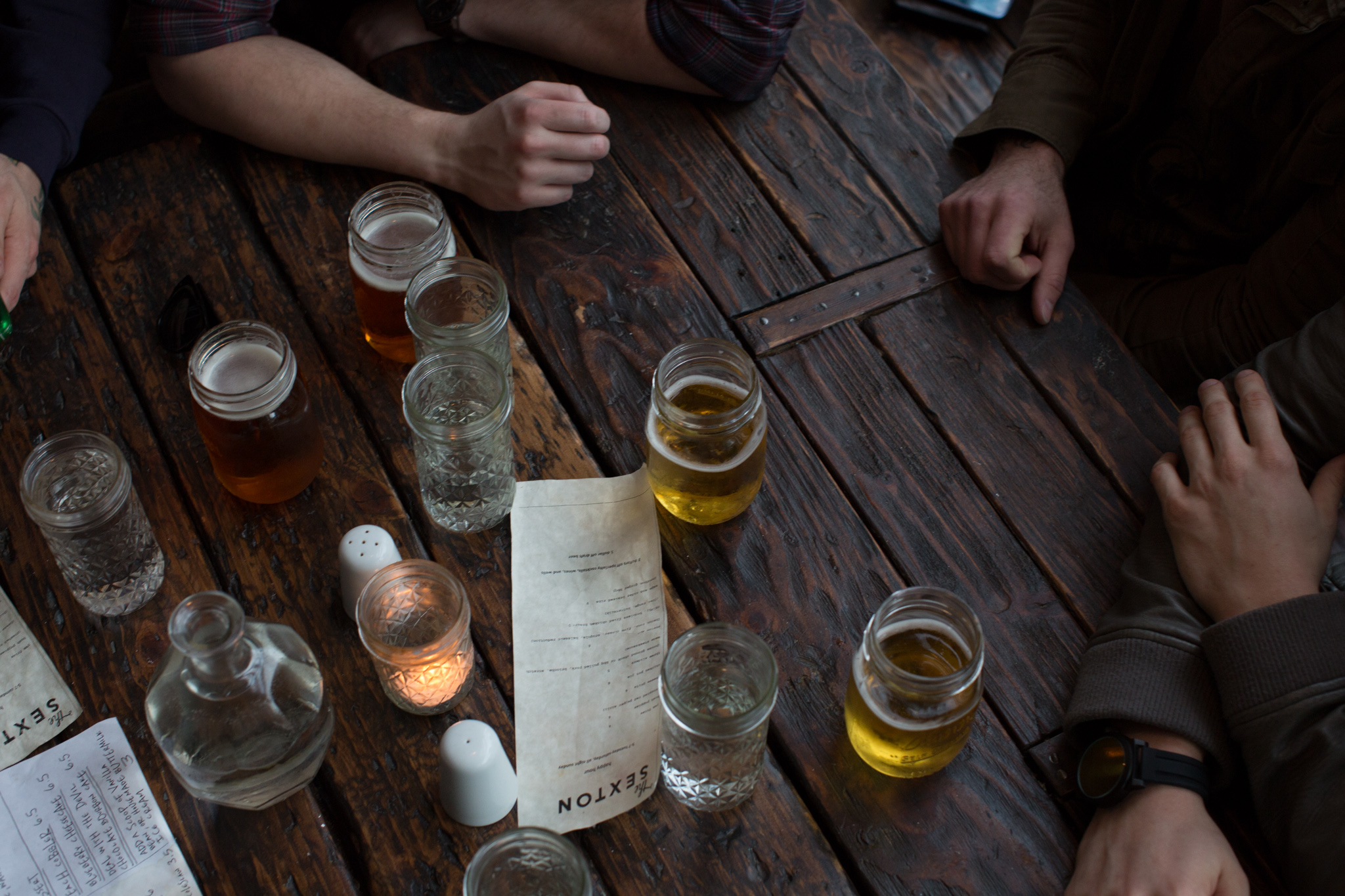 """The band, """"He Thinks He's People"""" celebrates a solid photoshoot with beers at the Sexton."""