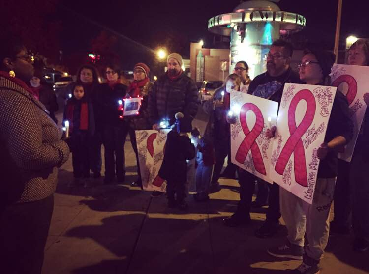 Dozens gather with candles in front of Tower theater on December 1, 2016 to read the names of those in the Fresno community who have been lost to AIDS. Megan Bronson / MY LGBT PLUS