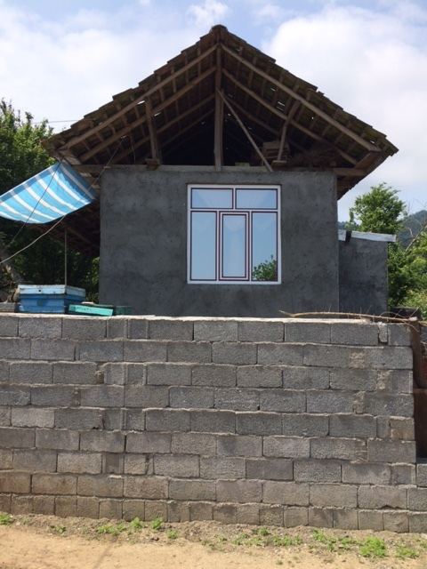 Old meets new: the traditional large wooden structures on top of concrete blocks with aluminum frames.