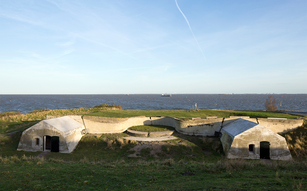 Open air theatre next to former ammunition bunkers that where transformed into small refuges where people can spend the night