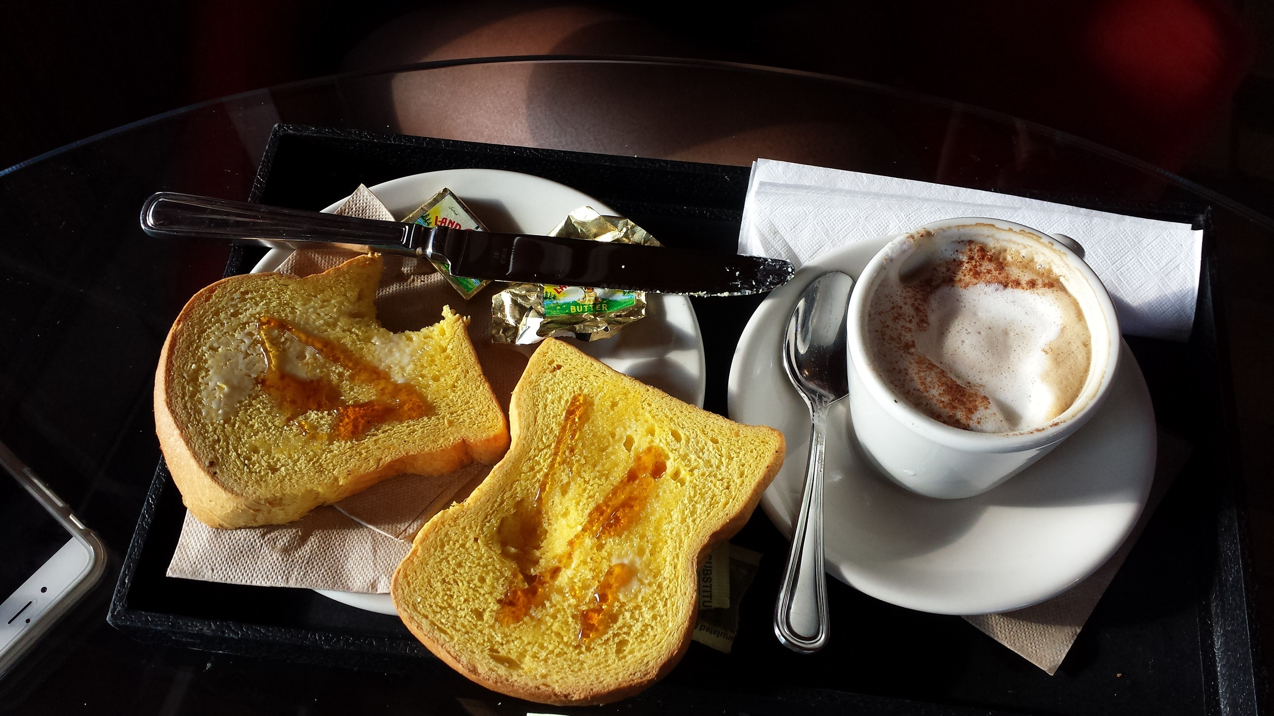 Texas toast with honey and latte.