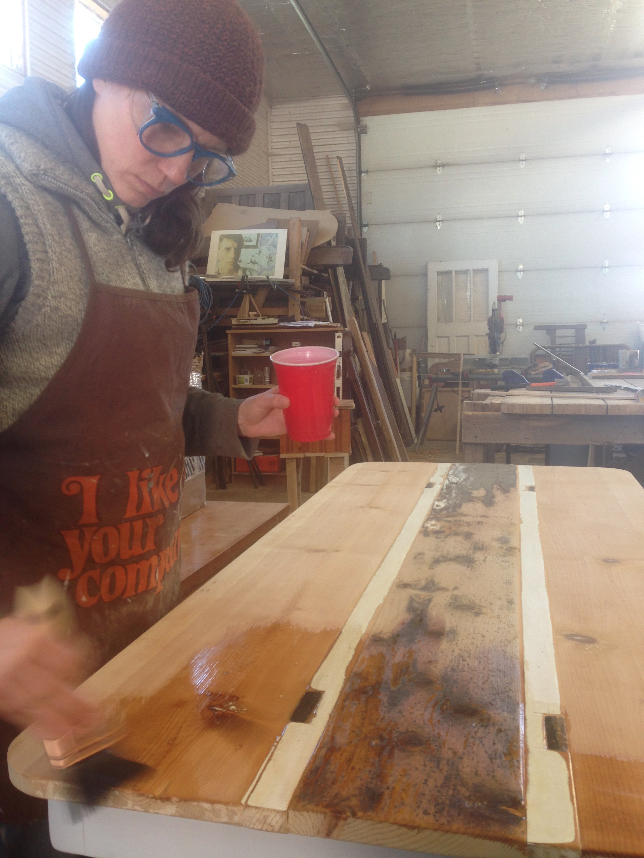 Heather's all bundled up to apply Tung Oil.