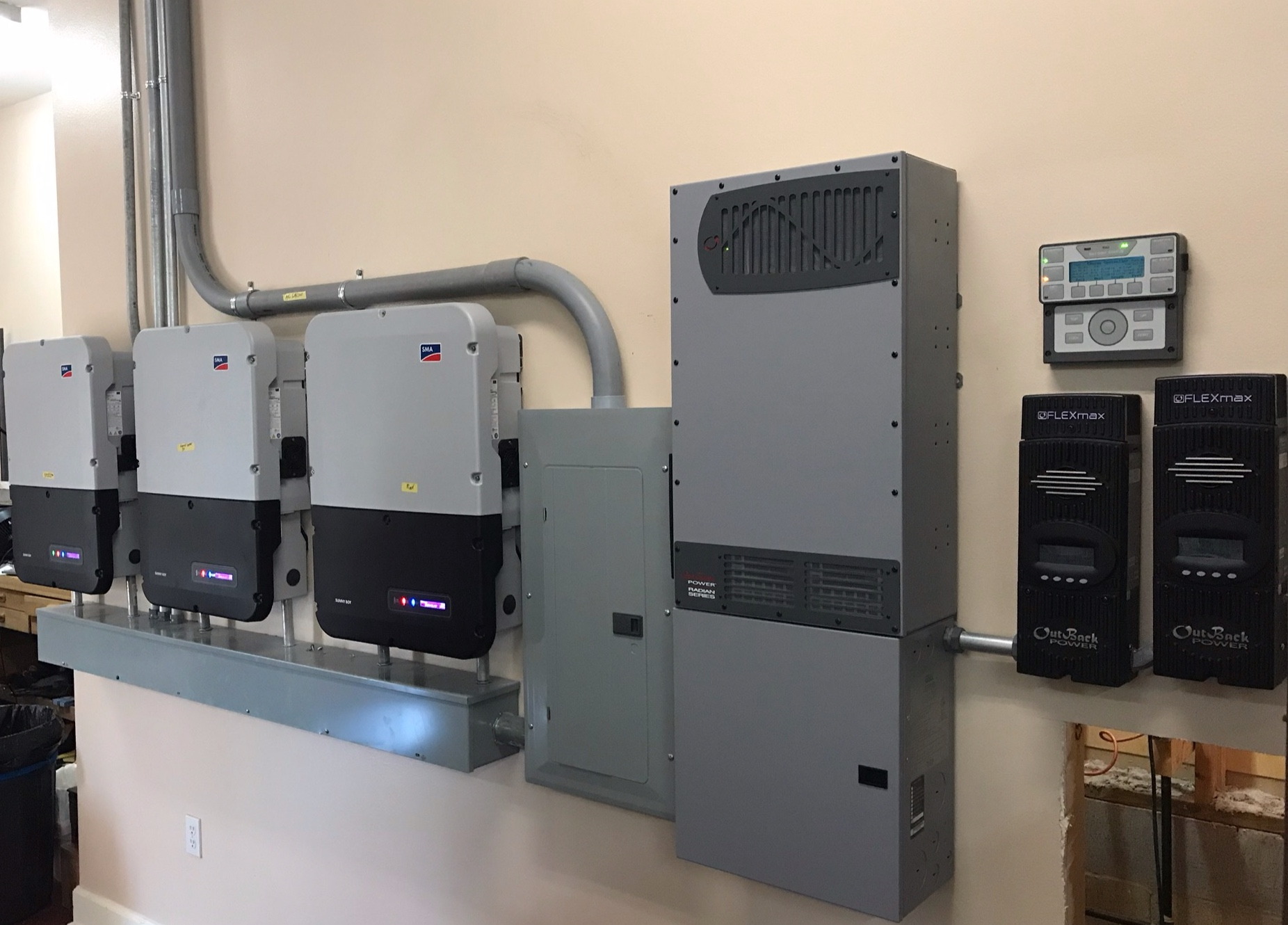 Large grid tie system with battery backup for emergency loads.