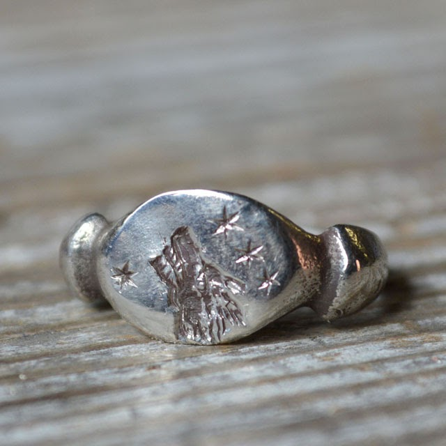 http://pegandawlbuilt.com/products/wolf-and-stars-ring