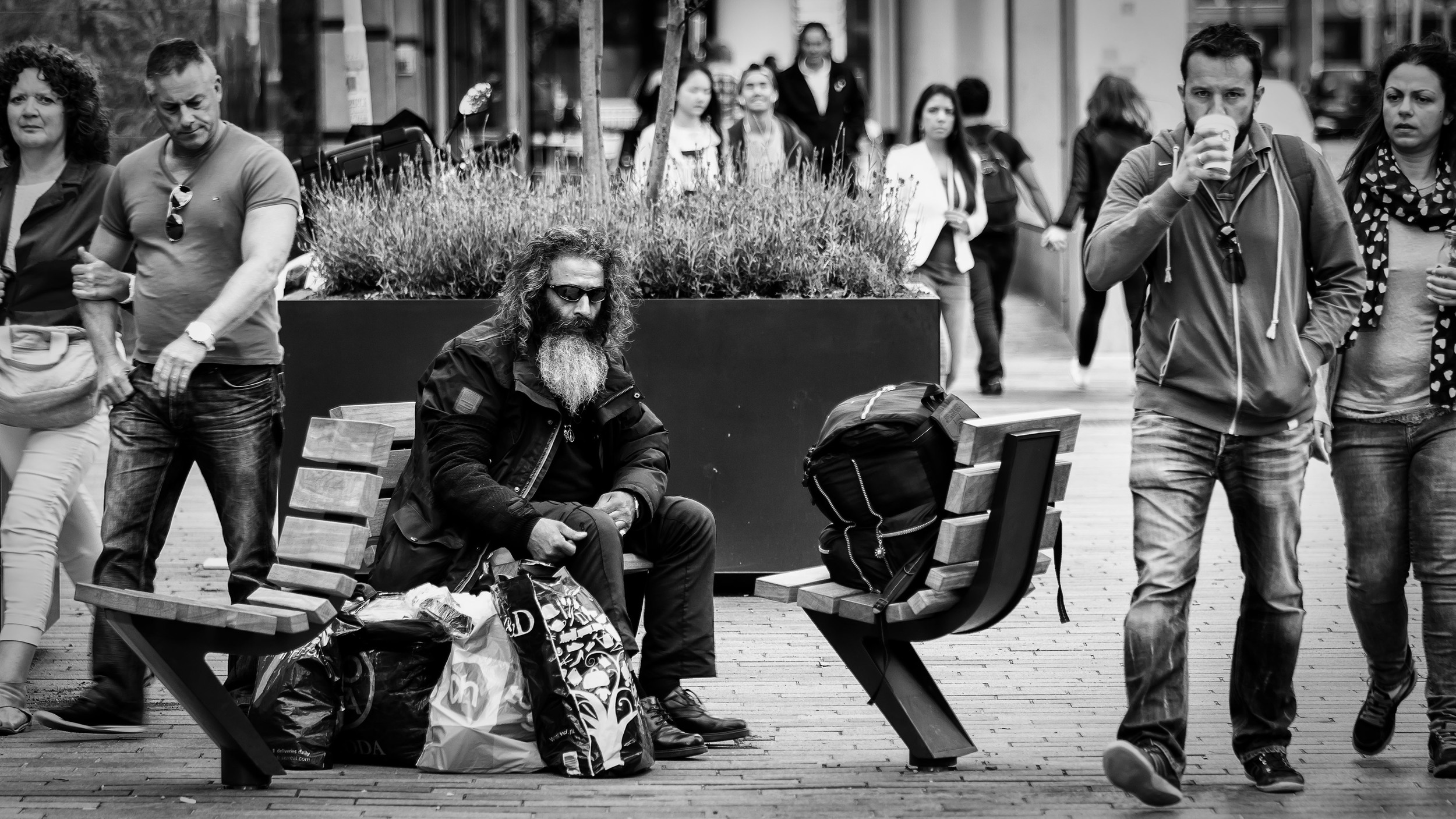 Unfortunate, disabled or society's rejected people  (click to enlarge) A homeless man in Rotterdam. Ignored and rejected by society. Not noticed anymore... Notice the expression on the face from the guy on the left while looking at him.