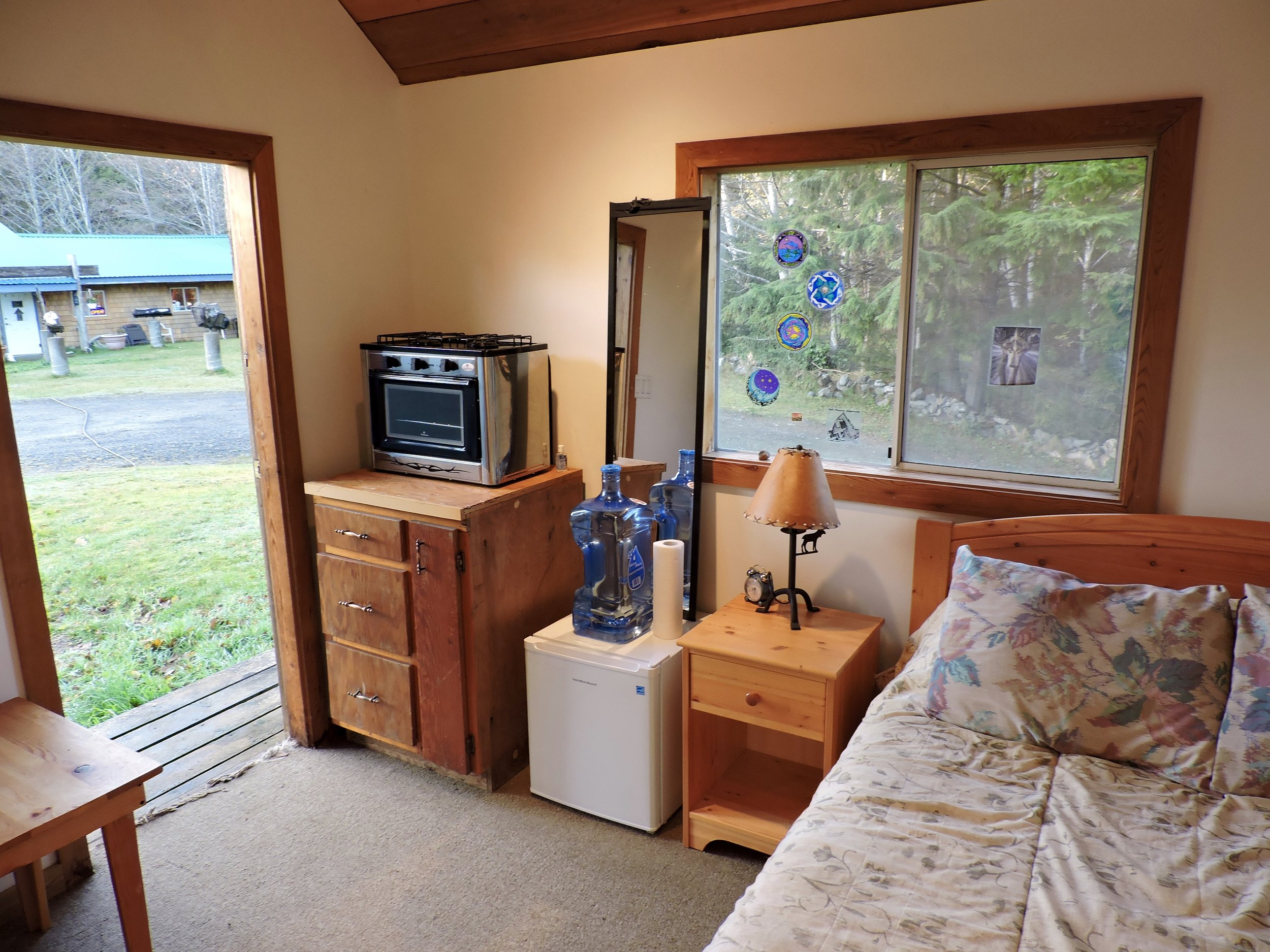 A rustic cabin rental is also available with queen sized bed, mini fridge & propane stove
