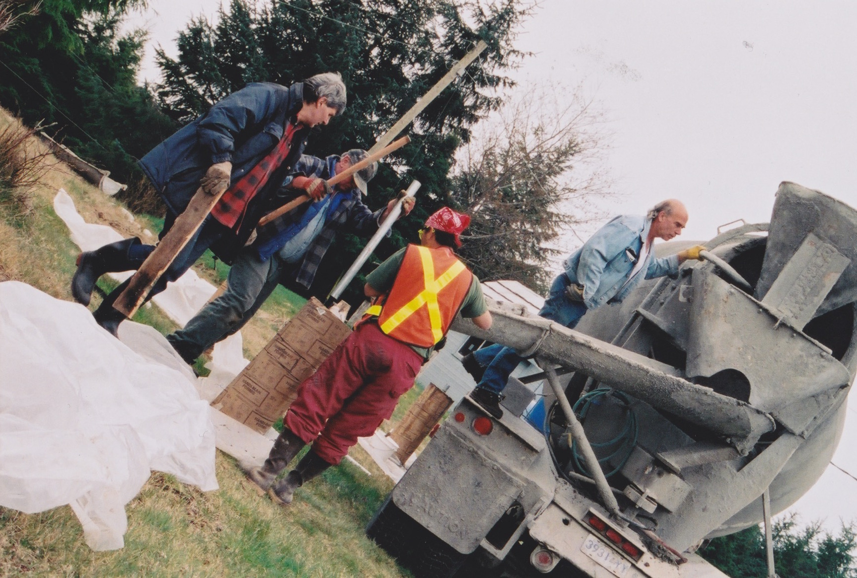 Pouring the East Beach Sand cement pillars that form the foundation of the Tlell Stone Circle.