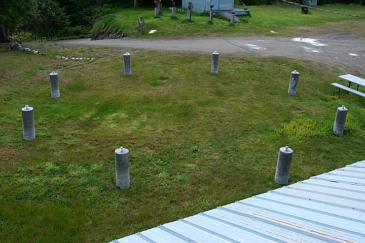 Arial view of the cement pillar bases of the Tlell Stone Circle. These pillars are made with Haida Gwaii East Beach Sand and reach six feet into the earth below.