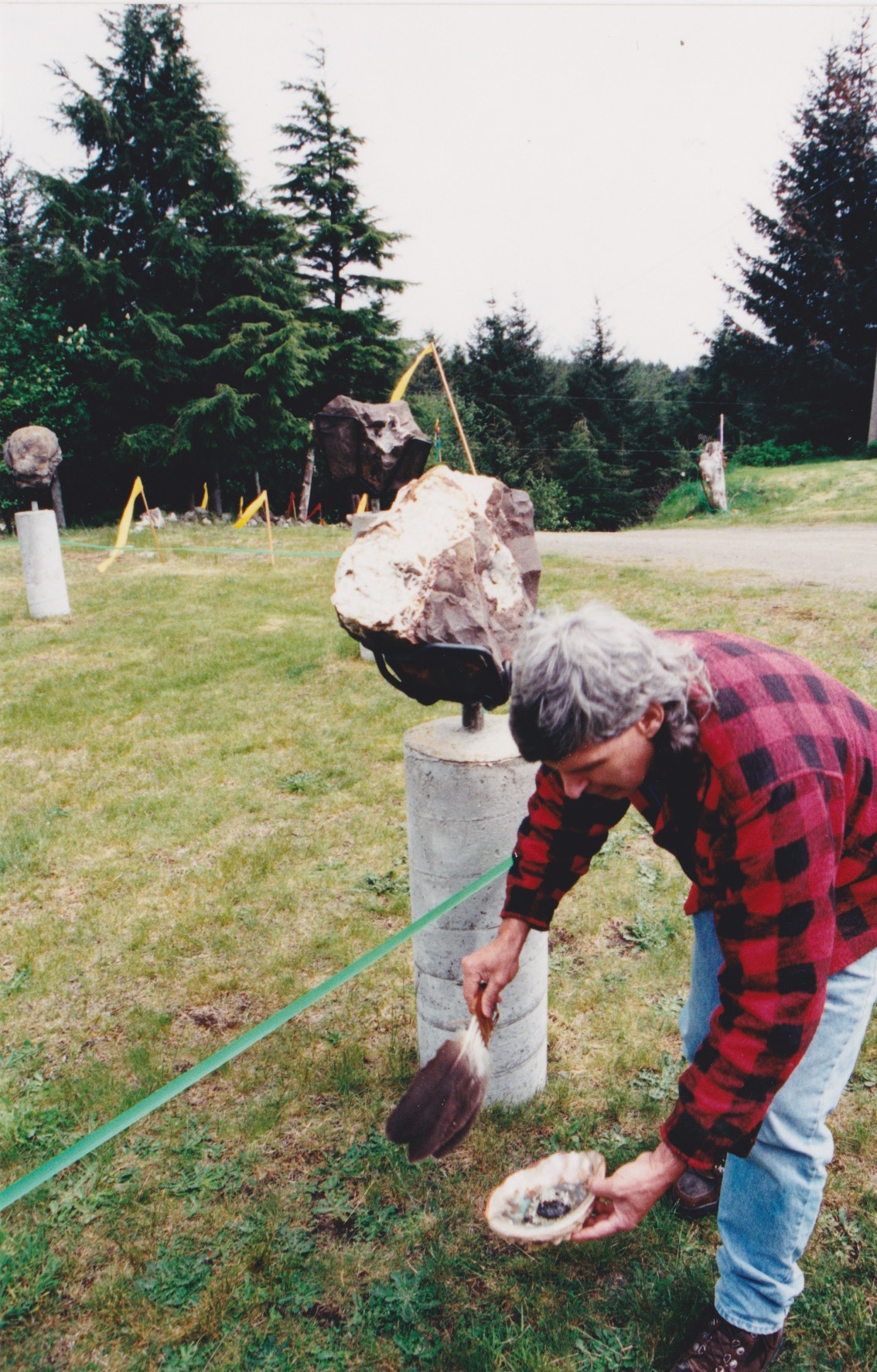 The late Dan Galloway smudging to the four directions at the opening of the Tlell Stone Circle in 2002.