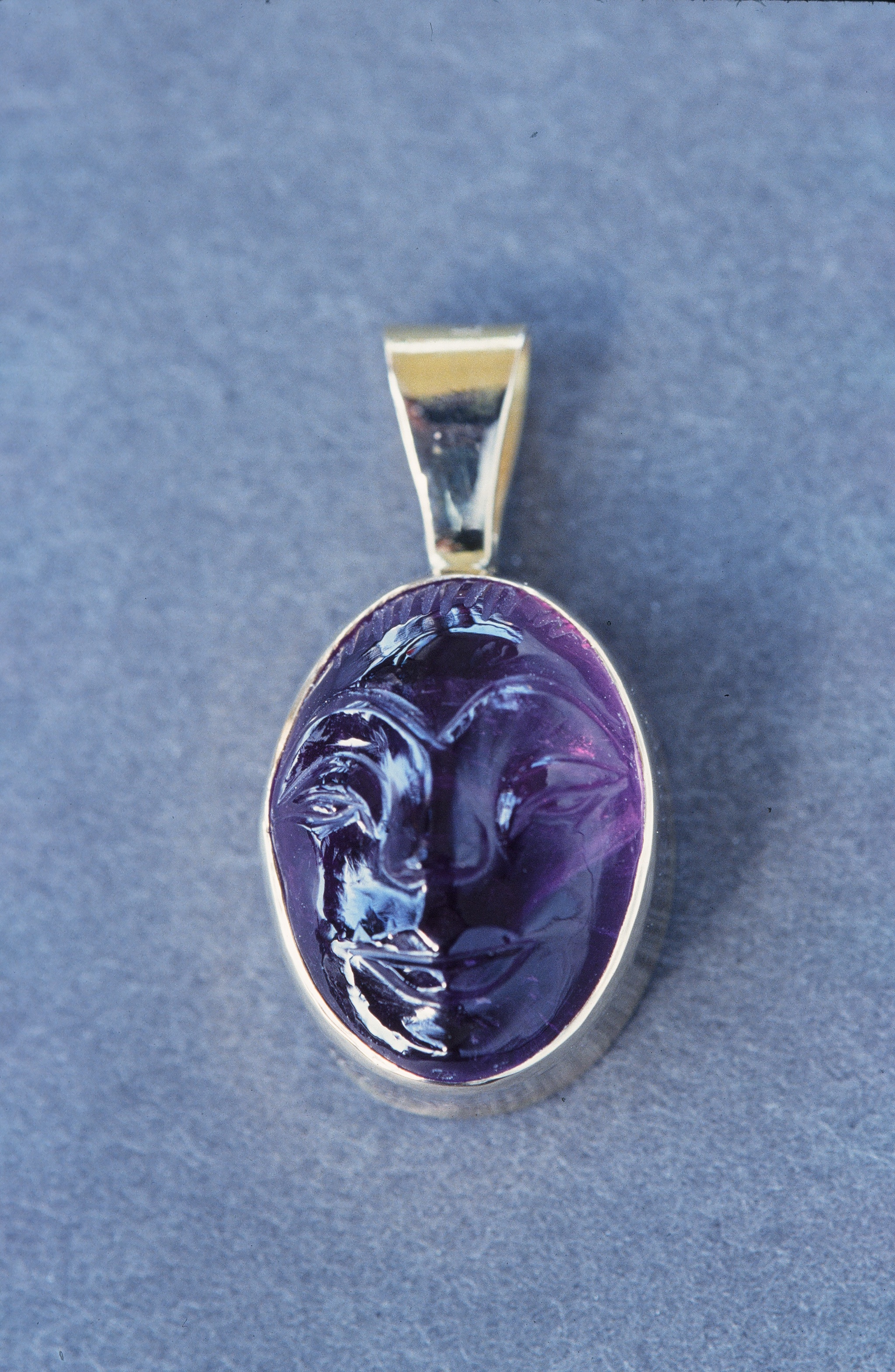 Carved Amethyst Face, set in 14K Gold. Inquire to custom order.