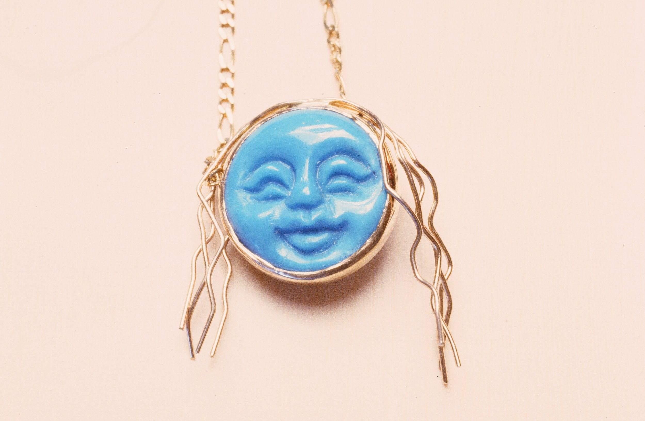 """Wild Woman"" Turquoise Carved Face set in 14K Gold. Inquire to custom order."