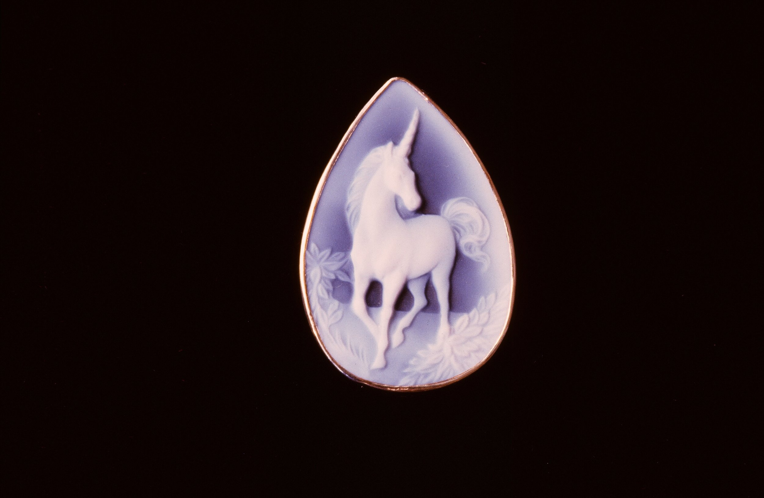 Carved Unicorn Agate Cameo, set in 14K Gold. Inquire to custom order.
