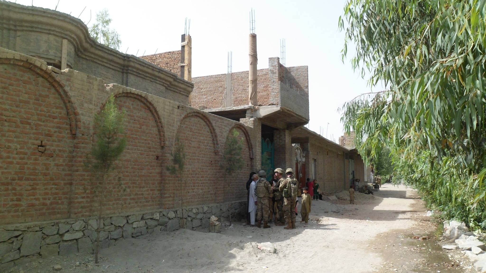 1LT Brehany conducts a community engagement with local Afghan villagers near Jalalabad, Afghanistan.