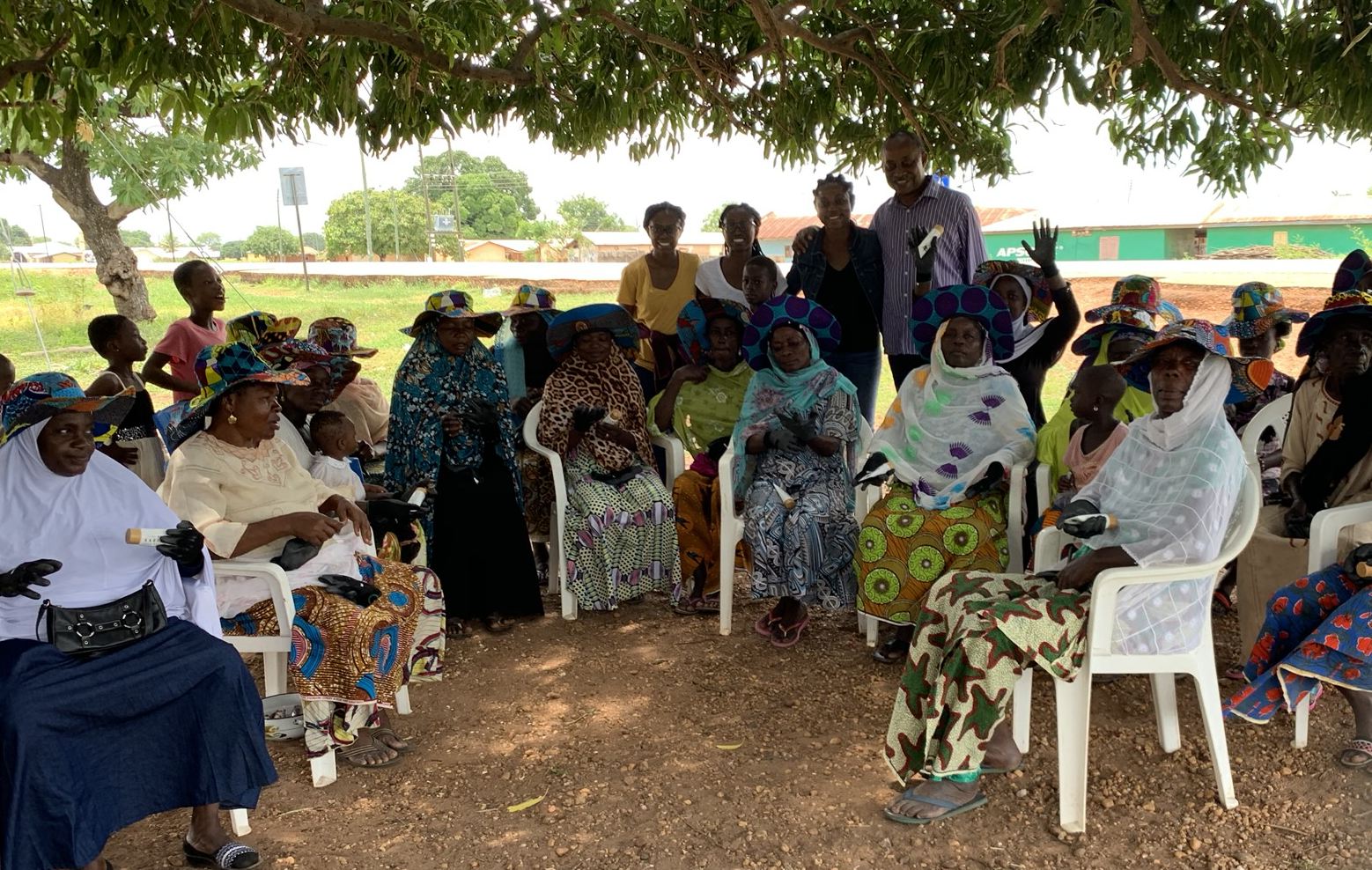 The founders of Karité with workers from women-run shea tree cooperatives in northern Ghana gather for a picture