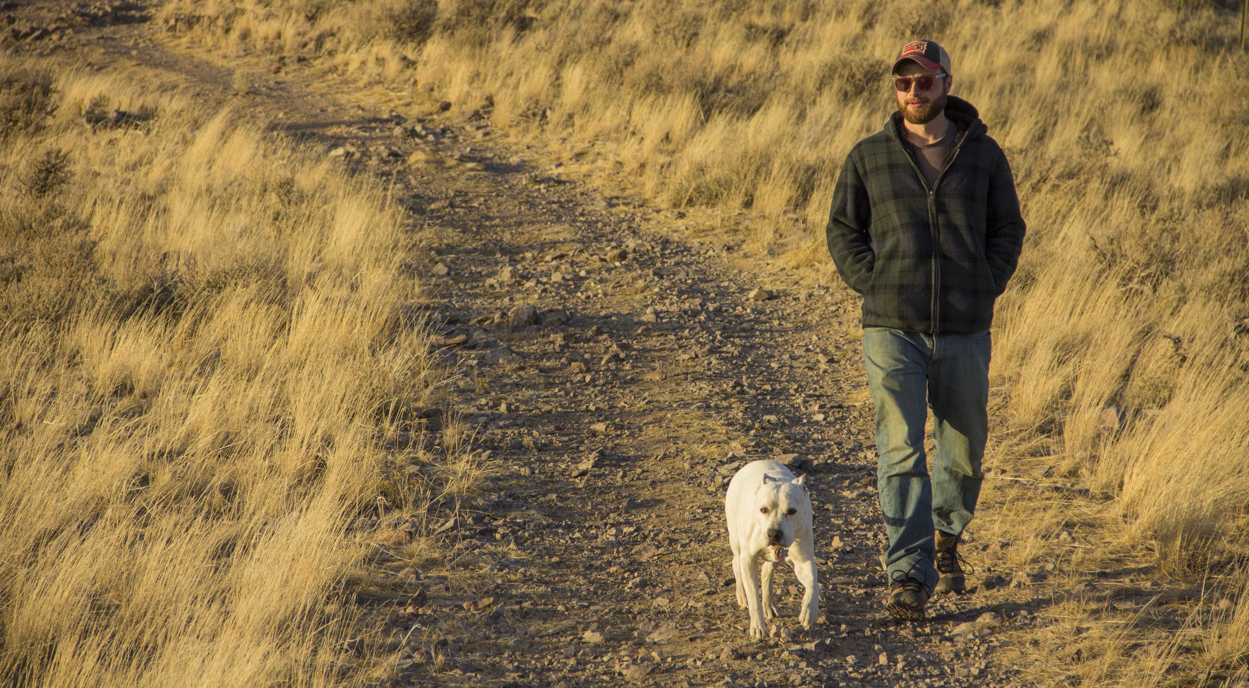 Chris Carparelli and his dog Jibz hiking along the Dillon Town Overlook Trail