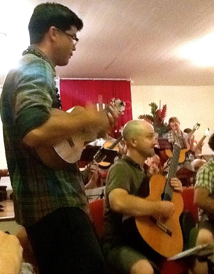Ian O'Sullivan performing on ukulele with the Maui Honu Guitar Orchestra (2014)