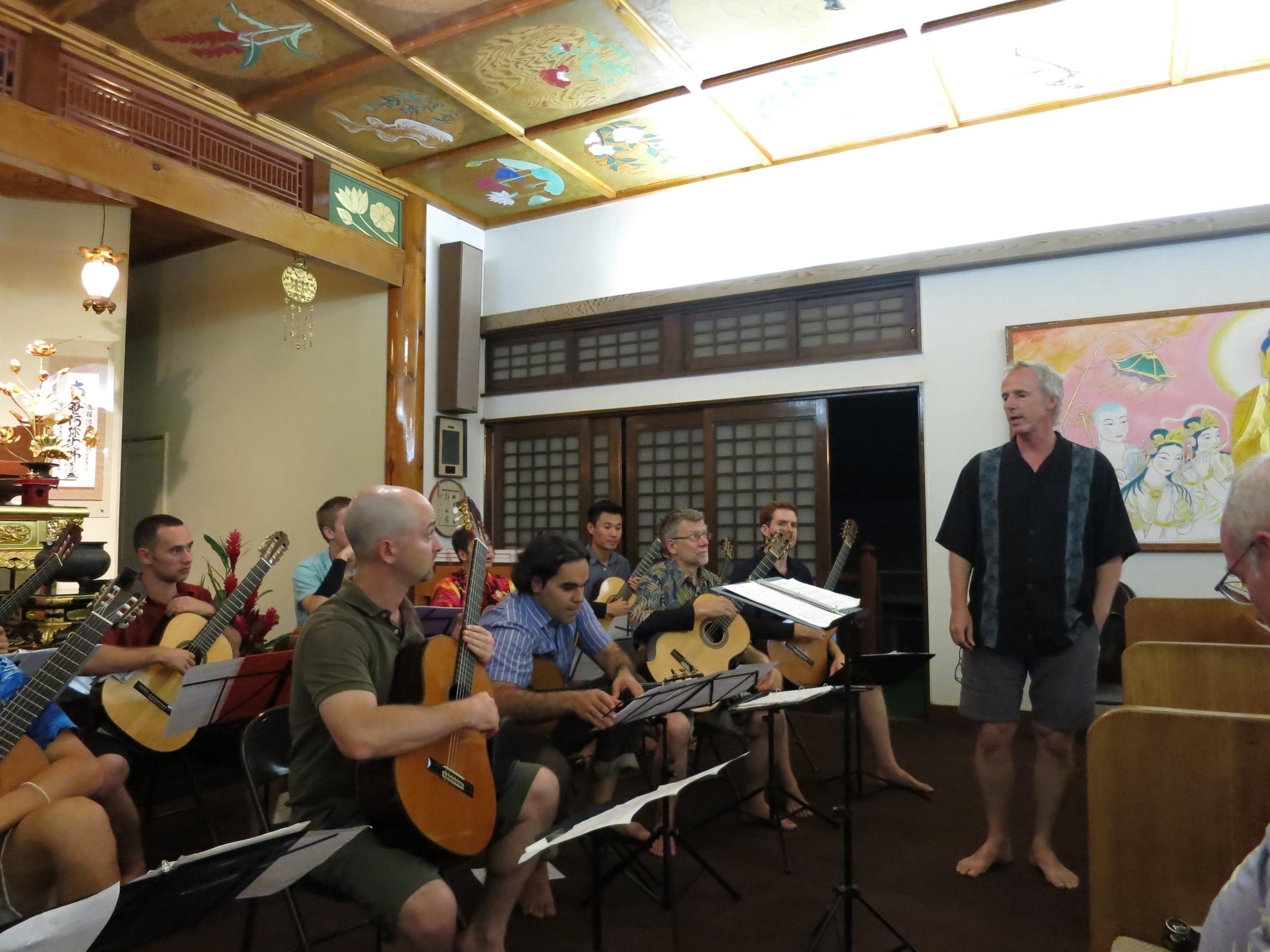 John Dearman rehearsing the guitar orchestra at the Lahaian Jodo Mission (2014)